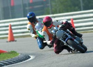 Here I am riding with my friend Paul who is helped get me fast enough to start dragging my knee.