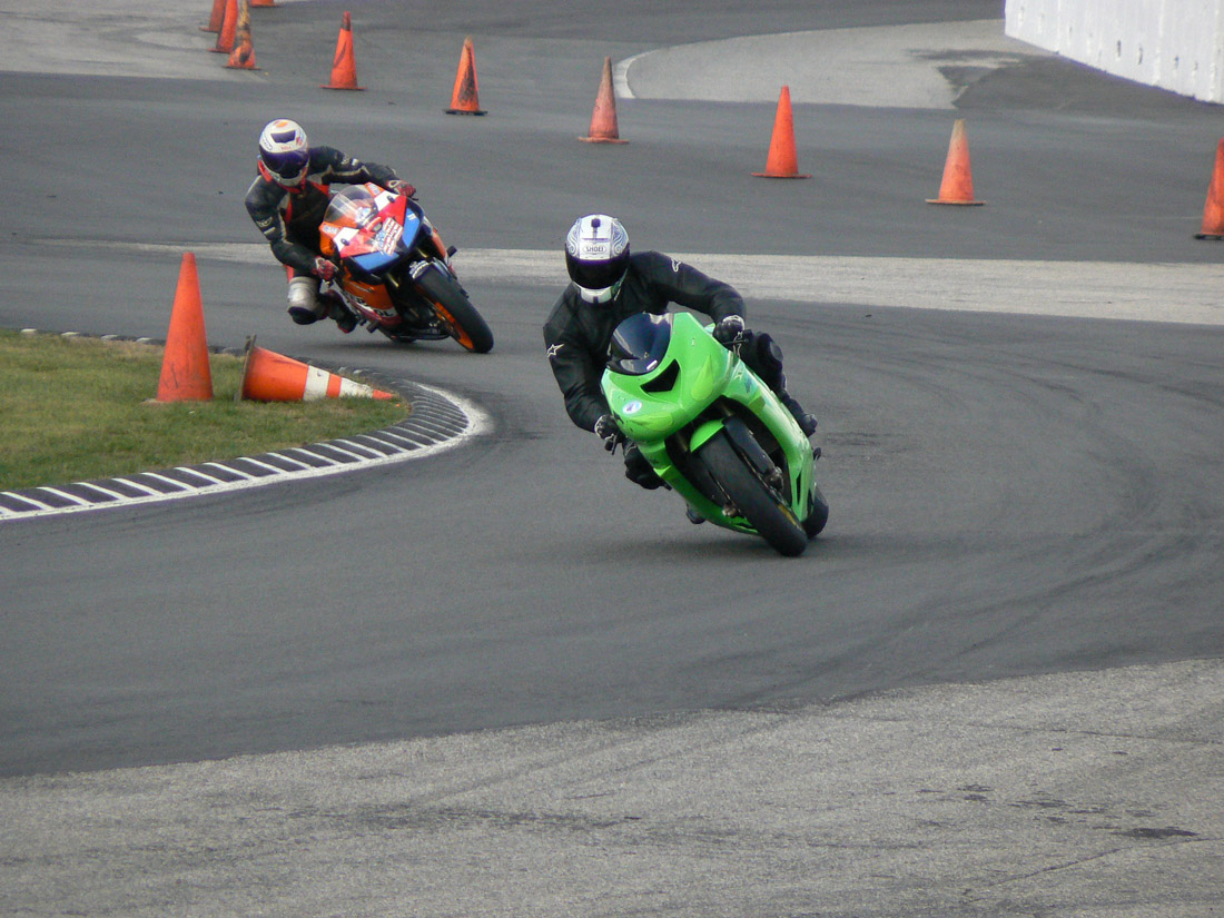 Motorcycle Track Days What You Need To Know Riding In The Zone Wiring Raceway Two Riders Going Through Turn 1a At Loudon