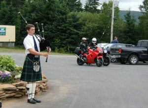 Here is a photo of a bagpiper. It has nothing to do with this article, but it does show the weird things you come across when on a motorcycle. Jeannine and Caroline look on.