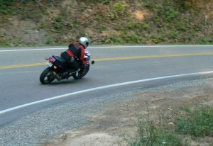 Managing traction while cornering downhill requires balance between speed control and acceleration.