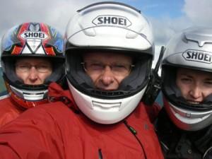 Three people, three motorcycles.