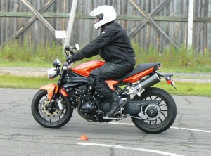 Squeeze the front brake progressively, but fully while at the same time easing off the rear brake to prevent a rear tire skid.